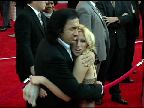 gene simmons and deborah gibson at the 2004 american music awards red carpet at the shrine auditorium in los angeles, california on november 14, 2004. - gene simmons stock videos & royalty-free footage