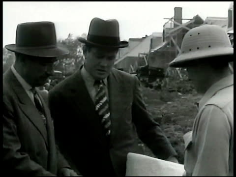 Gene Tunney on construction site talking w/ men looking at plans EXT Jack Dempsey's restaurant w/ framed photograph XWS EXT Jack Dempsey Broadway Bar