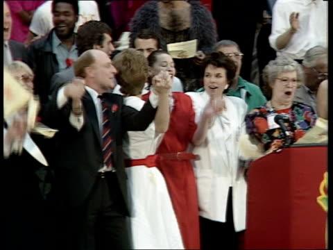 stockvideo's en b-roll-footage met labour ls kinnocks on stage with gospel chorus actresses glenda jackson miriam karlin anna wing singing we shall overcome sof zoom in kinnocks... - gospelmuziek