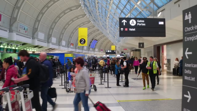 general ambience or atmosphere at pearson international airport in a busy morning in the departures floor, toronto, ontario, canada - toronto stock videos & royalty-free footage