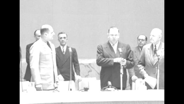 general assembly members file into room general mathew ridgway is second from left front row / cu ridgway trygve lie un secretary general and another... - matthew b. ridgway stock-videos und b-roll-filmmaterial