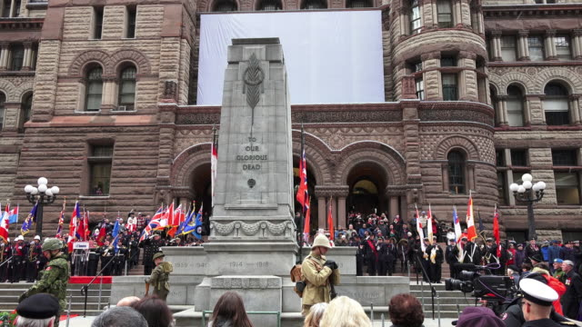 general atmosphere at the cenotaph in the old city hall building where the ceremony for remembrance day is held in the canadian city - armistice day stock videos and b-roll footage