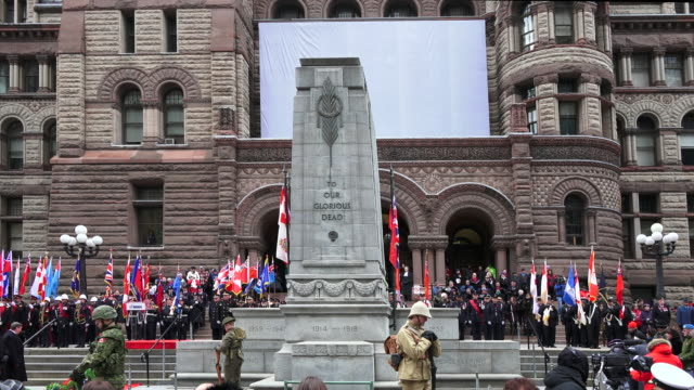 general atmosphere at the cenotaph in the old city hall building where the ceremony for remembrance day is held in the canadian city - remembrance day stock videos and b-roll footage