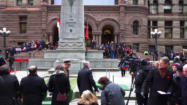 general atmosphere at the cenotaph in the old city hall where the celebration of remembrance day is held - remembrance day stock videos and b-roll footage