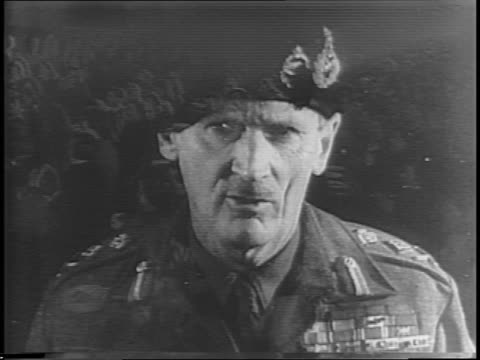 general bernard montgomery speaks to a crowd / audience laughs / wider shot of auditorium and stage / montgomery claims victory is not in doubt. - 1944 bildbanksvideor och videomaterial från bakom kulisserna