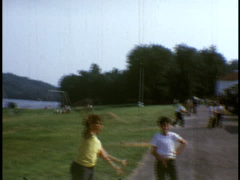 stockvideo's en b-roll-footage met 1973 ws general camp views, cabins, kids playing at camp sussex summer camp / sussex, new jersey - sociale geschiedenis