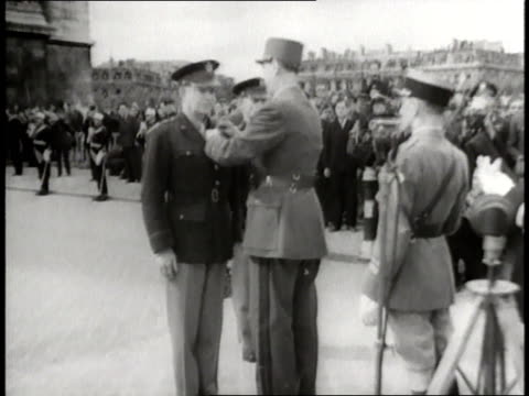 general charles de gaulle pins a medal on general dwight d eisenhower during a ceremony in paris - charles de gaulle stock videos and b-roll footage