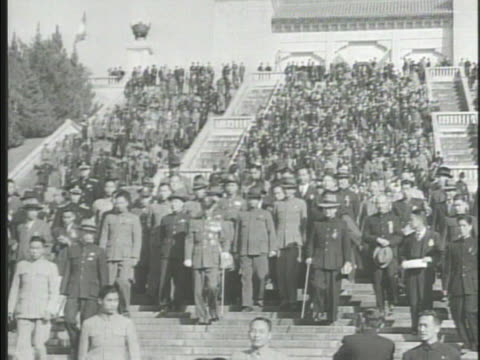general chiang kaishek in decorated uniform walking down steps w/ political military officers large group of chinese people - chiang kai shek stock-videos und b-roll-filmmaterial