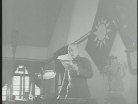 general chiang kaishek in shrinelike building speaking reading ms chinese official at desk signing papers w/ chinese mediator general george marshall... - chiang kai shek stock-videos und b-roll-filmmaterial