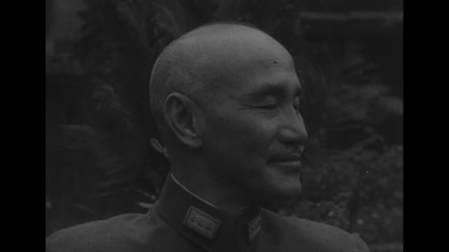 cu general chiang kaishek president republic of china smiling for photo op / note exact day not known documentation incomplete film has nitrate... - chiang kai shek stock videos and b-roll footage