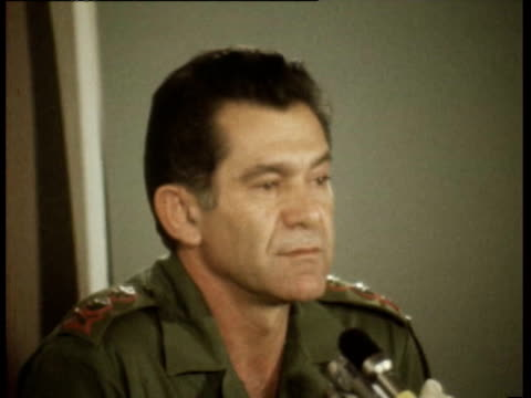 vídeos de stock, filmes e b-roll de general david 'dado' elazar at press conference giving update on progress of war in the golan heights and along the suez canal / he points out... - 1973