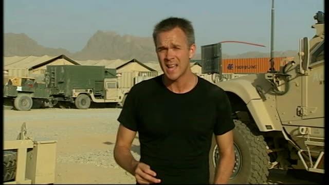 general david petraeus formally takes over command of nato forces; kandahar: reporter to camera - kandahar stock-videos und b-roll-filmmaterial
