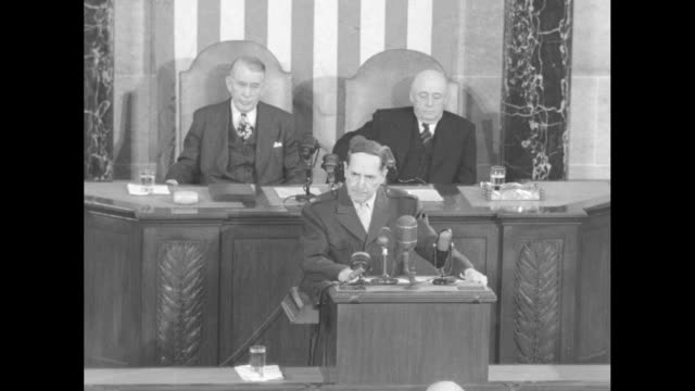 General Douglas MacArthur addresses joint session of Congress as Vice President Alben Barkley and Speaker of the House Sam Rayburn sit behind him the...