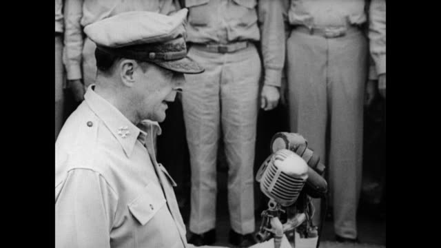 / General Douglas MacArthur approaches microphone and explains why everyone is gathered and invites the Japanese to sign the surrender document /...