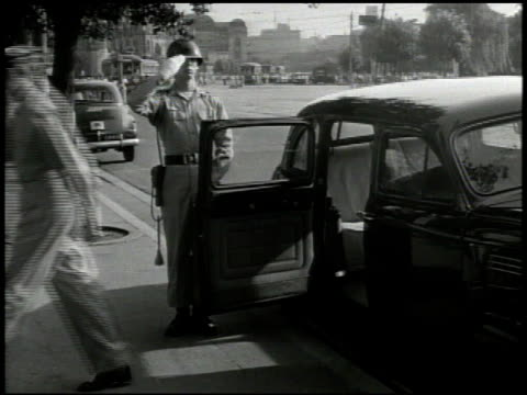 general douglas macarthur arriving exiting vehicle greeting japanese people on street entering building walking through halls w/ other officers world... - japanese surrender stock videos & royalty-free footage