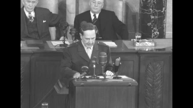 general douglas macarthur at lectern speaks to a joint session of the us congress about the rise in power of china vice president alben barkley and... - sam rayburn video stock e b–roll