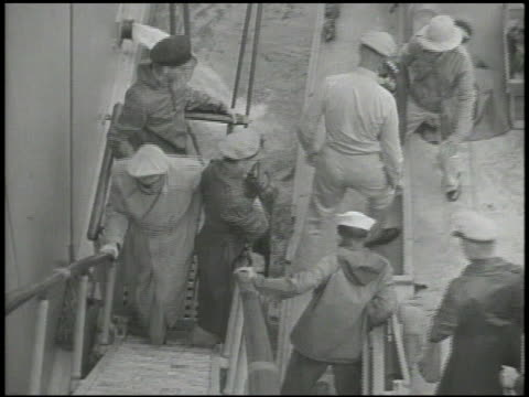 general douglas macarthur being helped from transport boat onto ship landing walking up stair steps ws general macarthur stepping onto deck saluting... - general macarthur stock videos & royalty-free footage