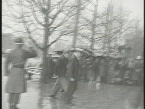 s general douglas macarthur exiting vehicle entering building vs various japanese people reading newspaper about 'macarthur replaced' vs convoy... - douglas macarthur stock videos and b-roll footage
