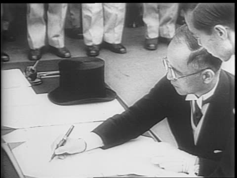 general douglas macarthur finishing speech at microphone / mamoru shigemitsu signs document surrendering unconditionally to the allied powers a... - japanese surrender stock videos & royalty-free footage
