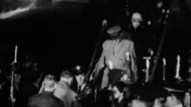 General Douglas MacArthur getting off plane / Philippines