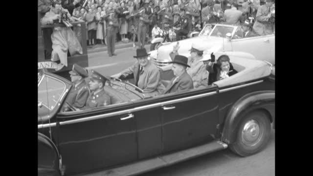 vídeos de stock, filmes e b-roll de general douglas macarthur honored upon return to us after having been relieved of his commands / motorcycle police in foreground limo with general... - general macarthur