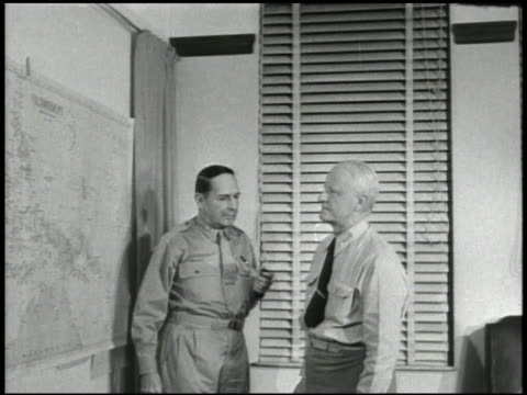 PLANNING General Douglas MacArthur pointing on wall map for Fleet Admiral Chester W Nimitz moving to desk covered w/ second map VS MacArthur amp...