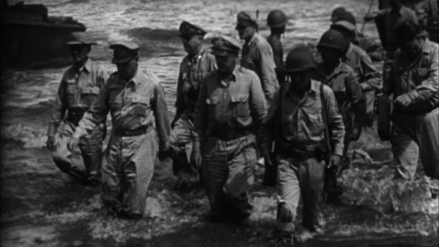 general douglas macarthur president sergio osmena and staff landing at palo / leyte philippines - general macarthur stock videos and b-roll footage