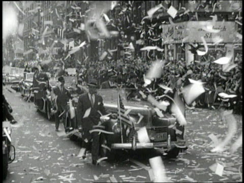 vídeos de stock, filmes e b-roll de general douglas macarthur rides in a convertible waving to an immense crowd during a ticker tape parade. - 1951