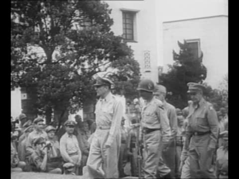 us general douglas macarthur shakes hands with maj gen william c chase of us army first cavalry division whose back is to camera upon arrival at us... - general macarthur stock videos & royalty-free footage