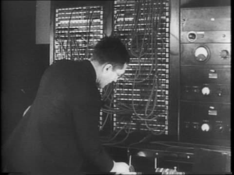 general douglas macarthur speaking via radio / view of radio towers man works on radio room / man working switchboard / man sitting working audio... - douglas macarthur stock videos and b-roll footage