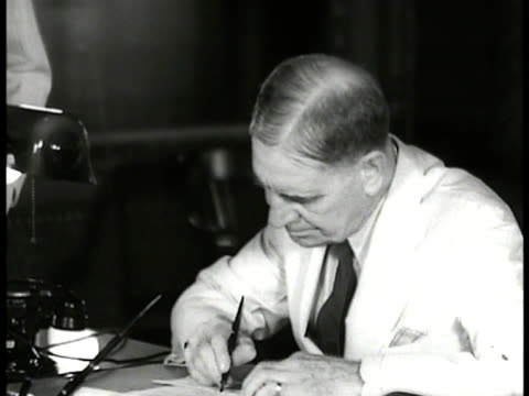 orders general douglas macarthur standing at desk of secretary of war george dern dern signing papers on desk george dern handing paper to macarthur... - general macarthur stock videos & royalty-free footage