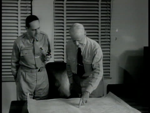 general douglas macarthur standing next to us allied commander in chief of pacific forces admiral chester w nimitz both at table looking at map... - allied forces stock videos and b-roll footage