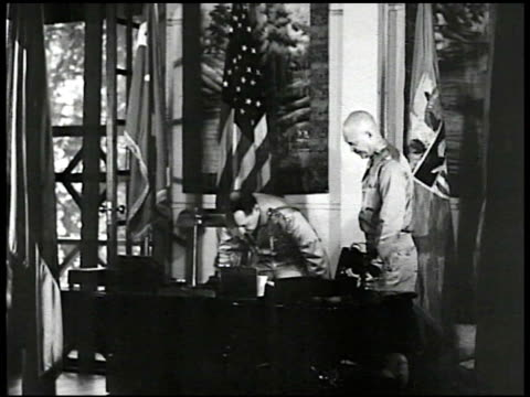 general douglas macarthur w/ major dwight d eisenhower at desk ms macarthur sitting eisenhower standing looking at papers handing them to eisenhower... - dwight eisenhower video stock e b–roll