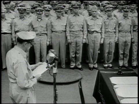 general douglas macarthur walking up to microphone on uss missouri japanese delegates including mamoru shigemitsu amp toshikazu kase standing vs... - japanese surrender stock videos and b-roll footage
