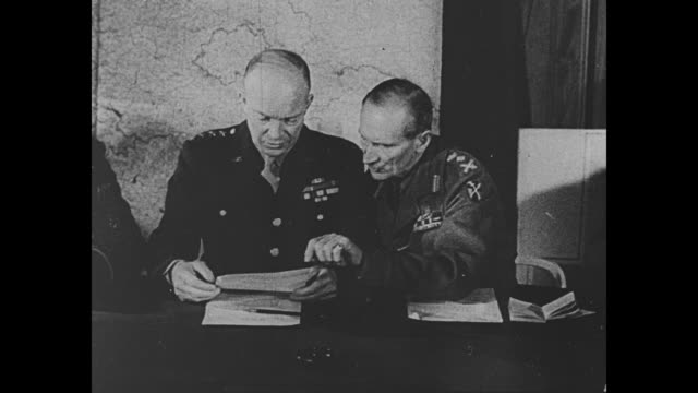 general dwight eisenhower and field marshal bernard montgomery sitting at table with other officers big map on wall behind them / ms eisenhower and... - d day stock videos & royalty-free footage