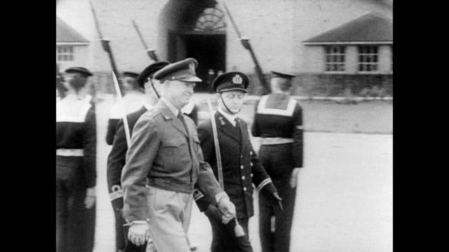 vídeos y material grabado en eventos de stock de general dwight eisenhower walks with his generals to inspect dutch troops in holland / walks past naval recruits / line of troops waiting by parked... - 1951