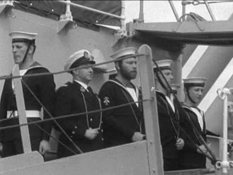 general eisenhower in portsmouth; england: portsmouth: ext general dwight d eisenhower out of car and shakes hands: crowd wave: waves to crowd and up... - concentration stock videos & royalty-free footage
