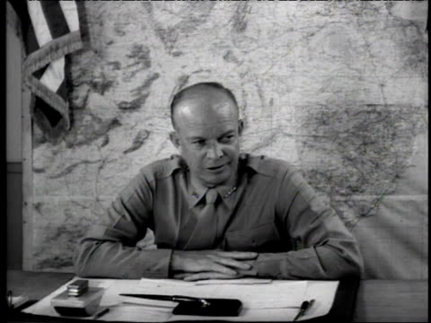 general eisenhower sits behind desk talks about defeat of germany in north africa to camera - 1942 stock videos & royalty-free footage