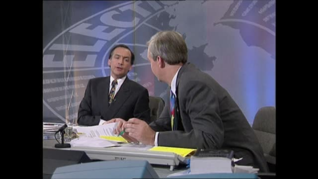 vídeos de stock e filmes b-roll de general election 1992: special: 23.00 - 24.00:; england: london: itn: int basement: john suchet live studio i/c with gfx showing itn election... - alastair stewart