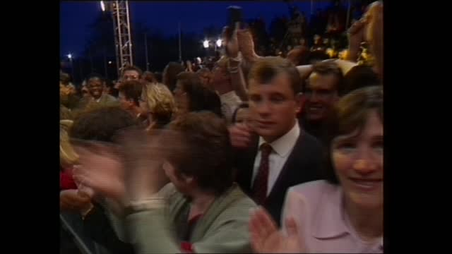 general election 1997: special: 04.00 - 05.00:; england: london: royal festival hall : ext night partying crowd constantly singing 'things will only... - celebratory event stock videos & royalty-free footage