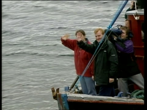 battle for pensioners vote pool scotland skye liberal democrat leader charles kennedy and girlfriend sarah gurling waving from boat as along pan... - charles kennedy stock videos & royalty-free footage