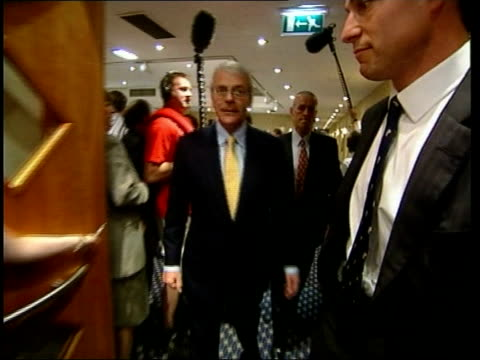 campaigning/margaret thatcher itn england brighton john major and wife norma in hotel lobby as major shaking hands with staff pan and commenting to... - tim rice stock videos and b-roll footage