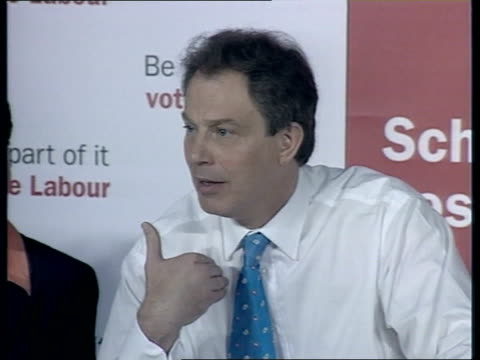 day's events itn england wellingborough tony blair along into labour press conference pan lms blair at podium as colleagues take seats ms press tony... - party poster stock videos & royalty-free footage