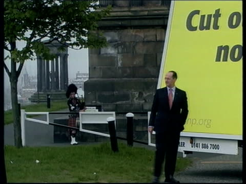 general election 2001: education/europe; scotland: edinburgh john swinney posing for photo call in front of campaign poster - photo call stock videos & royalty-free footage