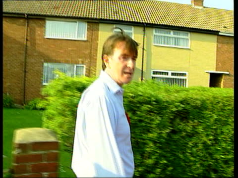 stockvideo's en b-roll-footage met hartlepool itn england hartlepool peter mandelson along street as canvassing mandelson supporters knocking on doors bv mandelson greeting voter in... - peter mandelson