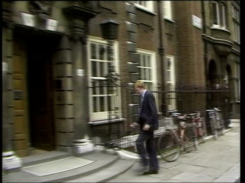 liberal democrats charles kennedy profile lib mat held webster england london younger kennedy along pull kennedy sat at table as man tells him what... - charles kennedy stock videos & royalty-free footage