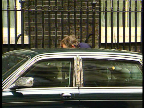 Preparations for announcement LIB ENGLAND London Downing Street Tony Blair MP along into no10 carrying guitar case red ministerial box as arriving...
