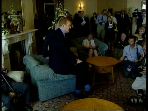 public services itn england devon charles kennedy along thru room on visit to old people's home gv residents sitting in lounge charles kennedy... - kissing hand stock videos & royalty-free footage