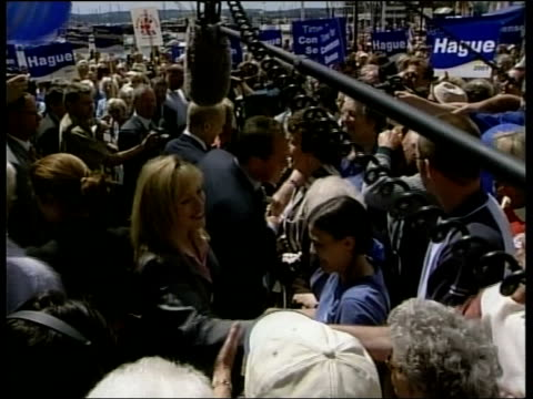 public services itn england westonsupermare people gathered at harbour ms william hague shaking with crowd pull out wife ffion tgv william and ffion... - weston super mare stock videos and b-roll footage