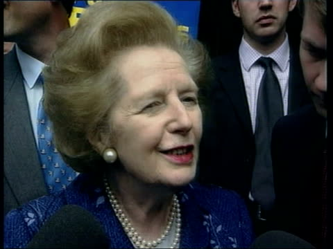 tory comments on labour landslide itn england hampshire romsey former prime minister baroness thatcher at checkout in sainsbury's supermarket... - liverpool england stock-videos und b-roll-filmmaterial